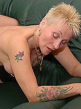 Rough tattooed grandma in cocksucking scenes