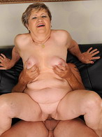 Lusty grandmother is sucking and playing with toy