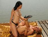 Overheated girlfriends fucking each at riverside
