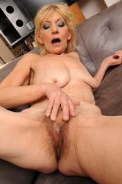 Hairy old granny Irene riding on a hard young cock