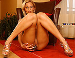 Blonde pornstar Mia Stone dildoing in her lingerie
