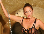 Hot Mandy Bright writhe between chains and candles