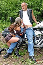 Vivien L sucking cock on motorbike
