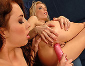 Lil blondie dildoing her busty girlfriends pussy