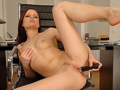 Teen brunette Jo is dildoing in the office