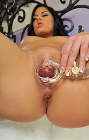 Madison Parker is stripping and inserts speculum