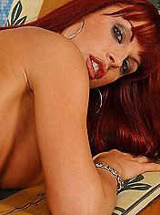 Busty redhead Sonya is fingering by the pool