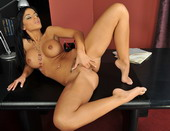 Sexy brunette Angelika is fisting her tiny pussy