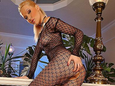 Blond babe fingering hard in a full body stockings