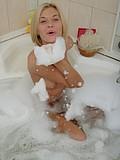 Smiling hottie posing in bathtub