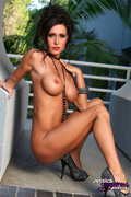 Jessica Jaymes is sexy and seductive as she strips and posed outside her Hollywood Mansion.