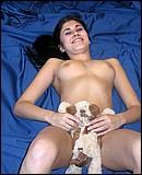 Sexy brunette teenage webcam girl showing her firm boobies