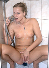 Teenage brunette enjoying herself under a steamy shower