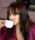 Brunette beauty seduces an old senior during her breakfast