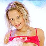 Blonde teenie showing her sweet body in a private foam bath