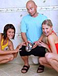 Two petite teenage cuties seducing a guy in the bathroom