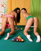 Two brunette lesbian teenies playing some dirty pool at home