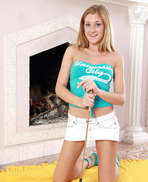 Cute teenage blonde toying her tight pussy at her house