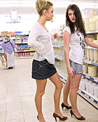 Two teen girls flashing their boobies in a grocery store
