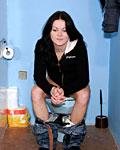 Brunette girl sucking a stiffy penis on a public toilet