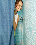 Busty teenage brunette spreads her slit under the shower