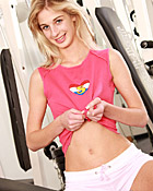 Tiny blonde teenie toying her pussy in the fitness room