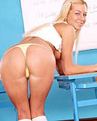 Naughty blonde schoolgirl is masturbating with a vibrator