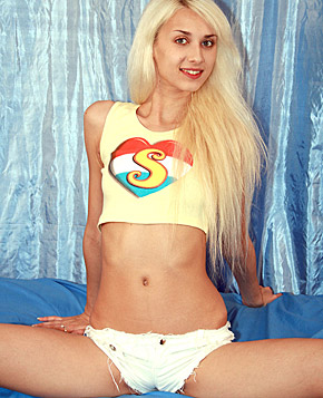 Skinny blonde teenager loves to abuse her massive dildo