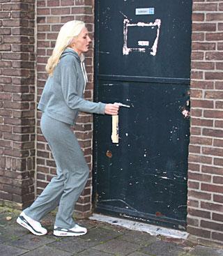 Blonde sucks an anonymous stiffy trough a gloryhole wall