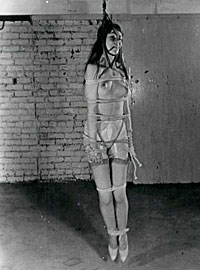 Seventies lady in a kinky mood tied up and exposed naked