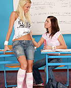 Two schoolgirls toying eachothers slit in the classroom