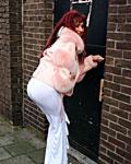 Skanky redhead slut enjoys a gloryhole cock inside her slit