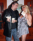 Heavy blonde hooker with big tits jerking an Italian cock