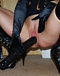 Nasty redhead slut stuffing both her loose holes with toys