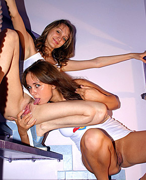 Two lesbo brunettes toying each others pussy on the stairs