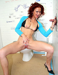Slutty redhead milf pleasing anonymous cock in a toilet
