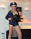 Slutty blonde female police officier strips fully naked