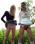 Two hot and sexy chicks love posing naked in the bushes