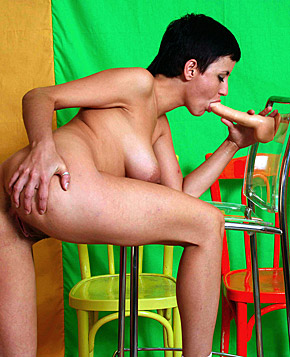 Hot girl with short hair masturbating on a chair with dildo