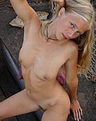 Horny cutie undressing in garden for wet clit pleasures