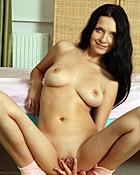 Masturbating chick is sucking on big rubber vagina cock