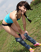 Very pretty teen chick pleasuring her soaked clit outside