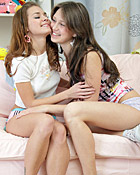 Two hot lesbian cuties playing with a big strap-on dildo