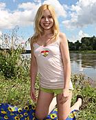 Naked and horny teenager masturbates near a lake using a toy