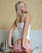 A sexy teenage sweetie likes masturbating with a tiny dildo