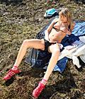 Sexy bikini wearing girl rubbing her soaked cooch outside