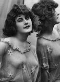 Vintage naked ladies looking in a mirror in the thirties