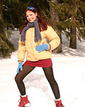 Girl masturbates in the cold snow with her moist fingers