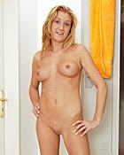 Cute naked girl enjoys sexual fun in a small locker room