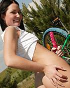 Cute bike riding sweetie rubbing her moist teenage cunt